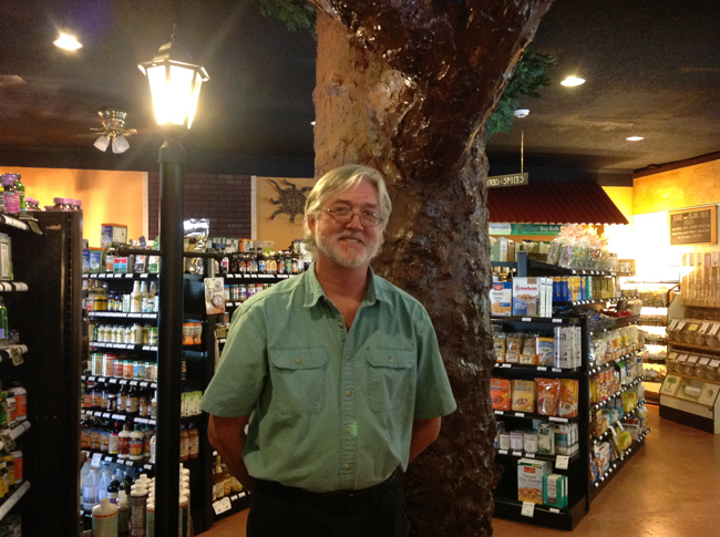 Sean Bossie, Owner of Whole Health Natural Foods next to his Tree of Life!
