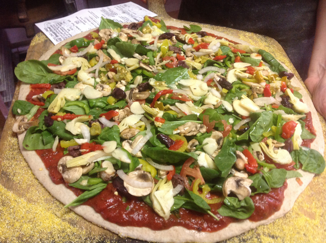 Freshly prepared pizza just before going into the oven