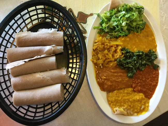 To Eat Ethiopian Food Unroll A Piece Of Injera And Pinch Portion The Stew Within Folds Your Then Just Pop It Into Mouth